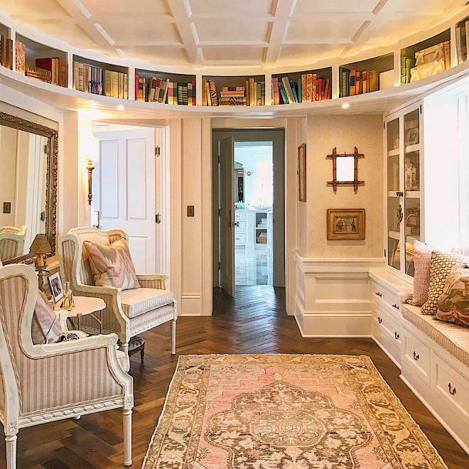 Landing with curved walls, curved bookcases, window seat, built-in cabinets, coffered ceiling and herringbone wood floors. Beautiful Homes of Instagram @SweetShadyLane