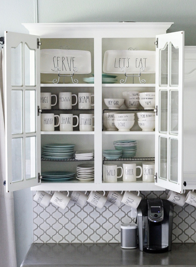 Mugs. Kitchen cabinet mug ideas. Collection of hard-to-find Rae Dunn dishware that she has collected over time, along with her collection of vintage LuRay dishes in soft blue/green.  #mugs #kitchen #cabinet #mug Home Bunch Beautiful Homes of Instagram @cottonstem