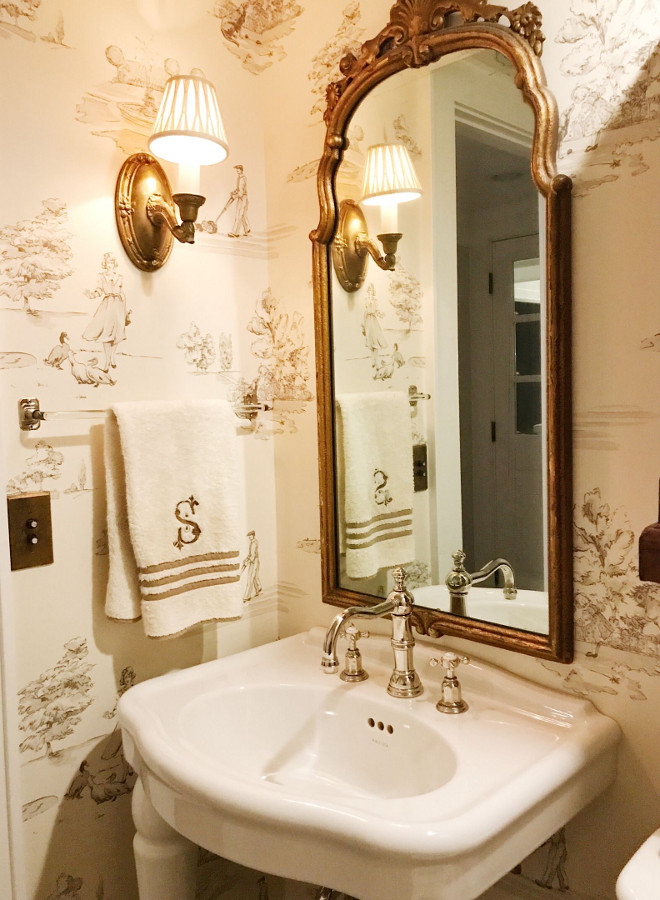 """Powder room wallpaper and gilded mirror. Powder Room with antique mirror and sconce with the my favorite, Nina Campbell """"promenade"""" wall covering. Sink and faucet by Kohler. Towel bar is antique. #powderroom #wallpaper #gildedmirror Beautiful Homes of Instagram @SweetShadyLane"""