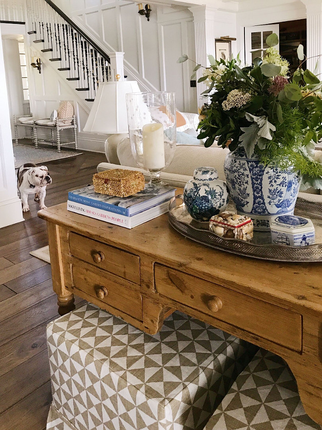 Sofa table decor. Sofa table decor with blue and white ginger jar, design books, glass hurricanes, vintage decir amd table lamp #sofatabledecor Beautiful Homes of Instagram @SweetShadyLane