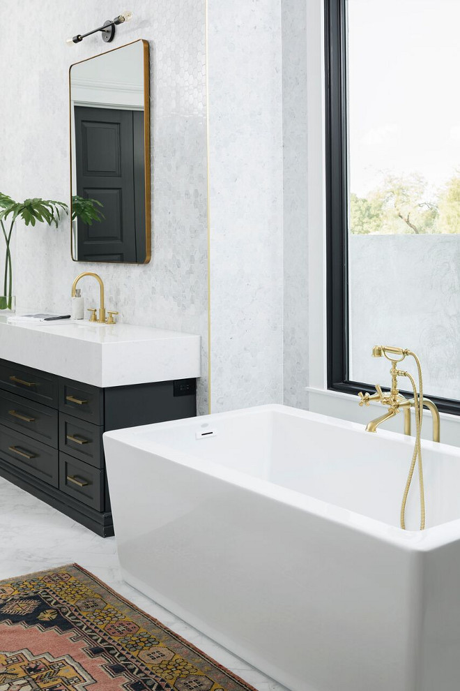 Bathroom with black and gold finishes. New trend black and gold. New interior design trend black and gold. #interiordesigntrends #blackandgold A Finer Touch Construction