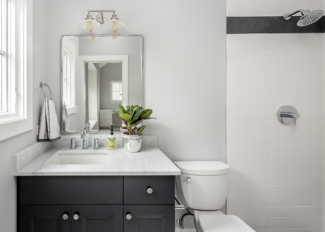 Black and White Farmhouse Bathroom Modern Farmhouse bathroom with black and white color scheme #modernfarmhousebathroom #blackandwhitebathroom