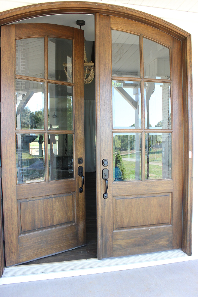 Double wood and glass arched front door with Oil-based stain by Sherwin Williams - Beautiful Homes of Instagram Home Bunch