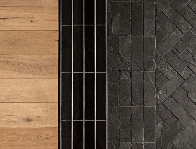 """We installed black granite inside of the track itself to blend the black door to the track. The exterior patio features black slate installed uniformly on the 4"""" curb. The rest of the patio has black slate installed in a herringbone pattern. The interior of the home has engineered wood flooring. Great design choices and color palette. A Finer Touch Construction"""