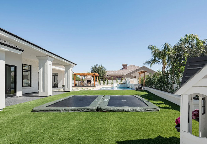 Underground trampoline. Backyard with underground trampoline. The patio doors open to an expansive backyard with two underground trampolines, playhouse and a pool area. #undergroundtrampoline A Finer Touch Construction