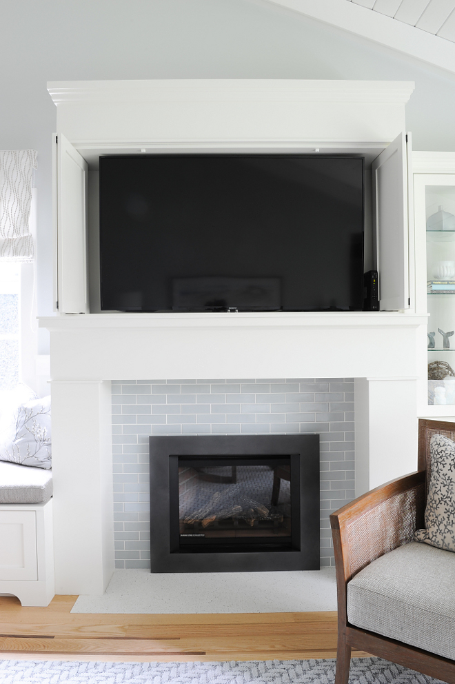 Hidden TV Fireplace Hidden TV The TV is carefully concealed in the custom millwork above the fireplace Hidden TV