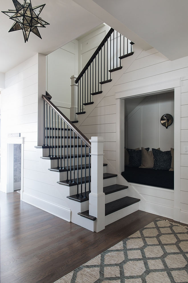 Reading Nook under stairs A staircase with shiplap leads to the basement Notice the reading nook under the staircase Under stairs nook Under stair reading nook Under stair reading nook plan
