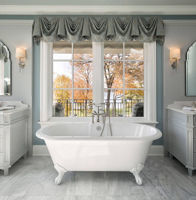 Traditional Bathroom with freestanding bathtub and window placed at eye level