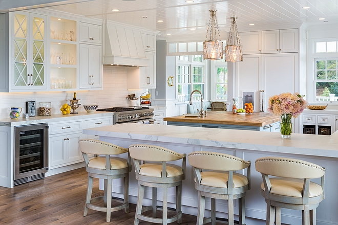 White Kitchen Classic White Coastal Kitchen with white cabinets and V-Groove ceiling and white trim White Kitchen Coastal White Kitchen