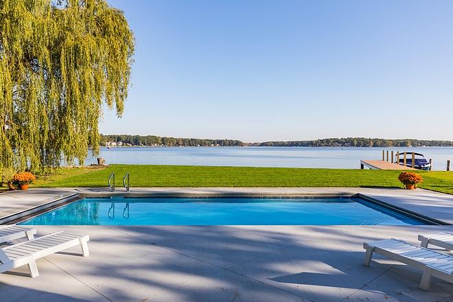 Lakehouse pool with concrete surround patio