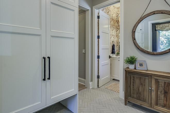 Herringbone Floor Tile Mudroom features herringbone floor tile: American Olean Brick Paver Tile Cashmere Court 2x8 #mudroom #tile #HerringboneFloorTile#HerringboneTile