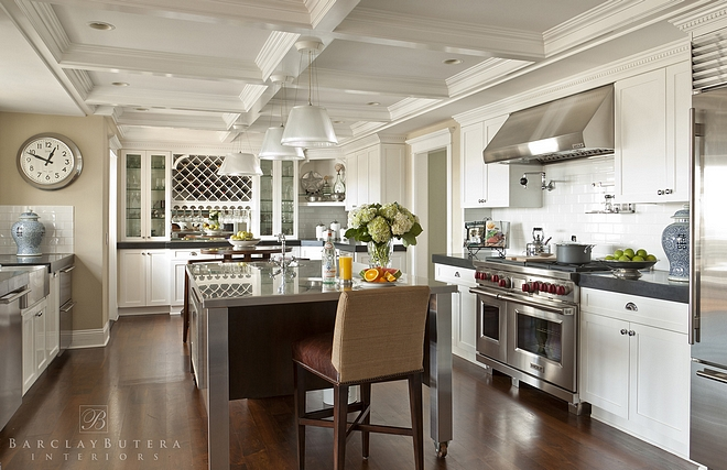 Traditional White Kitchen Traditional kitchen This traditional white kitchen features a handy movable island and beautiful millwork