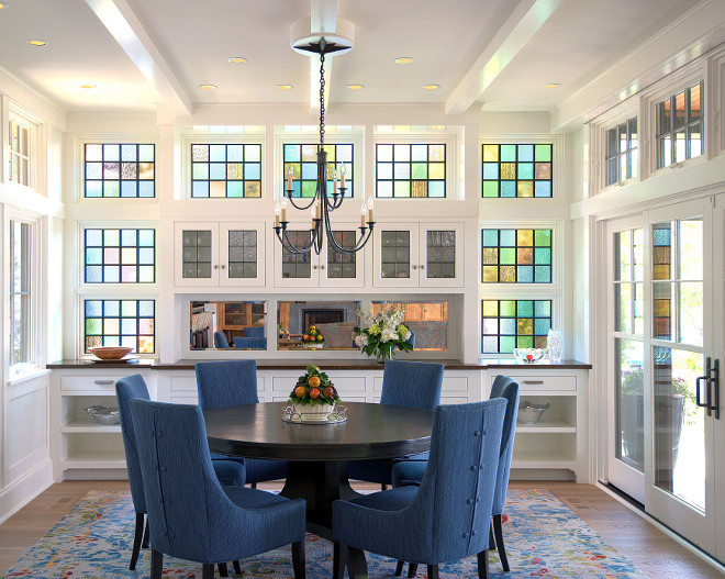 Dining Room with leaded-glass window Subtle nods to the nautical are found throughout the home — including in this leaded-glass window wall The art glass both screens a neighbor 's house from view and glows in afternoon light