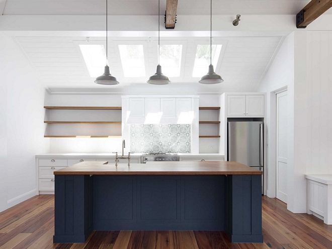 Kitchen skylight Kitchen features three skylights and hand-painted backsplash tile, Duquesa Tile by Walker Zanger, Coastal farmhouse kitchen with skylights shiplap ceilinh and beams