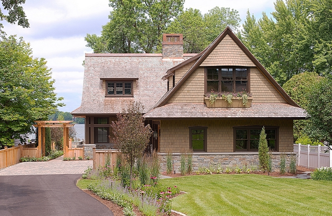 Lakehouse Architecture Design Using historic Excelsior shingle-style lake houses as precedent, TEA2 Architects created a modest 1-1/2 story gabled form with low eaves and upper level rooms that are fully within the roof