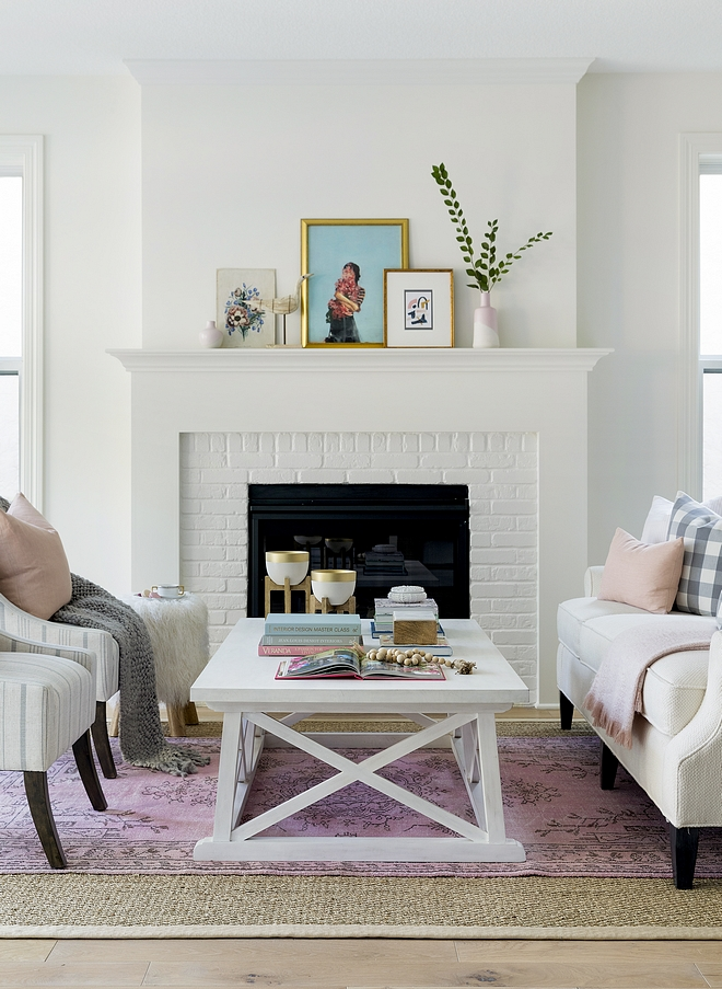 White living room fireplace The living room features a painted brick fireplace and inviting decor #livingroom #whitefireplace #paintedbrick