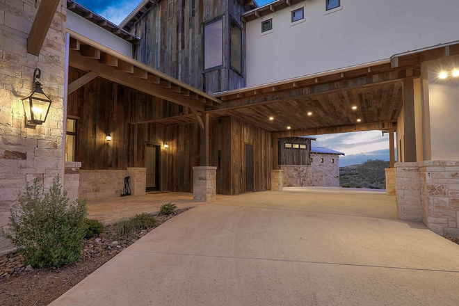 The porte-cochère features extensive use of reclaimed barnwood