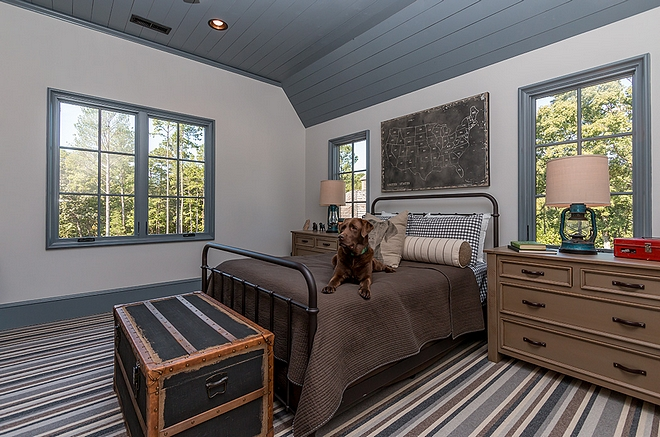 Industrial Farmhouse Boys bedroom with striped carpet shiplap ceiling and black metal bed #bedroom #industrialfarmhouse #blackmetalbed