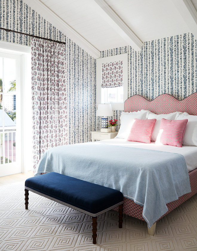 I feel like every house needs wallpaper in at least one of the bedrooms this wallpaper with the climbing stalks felt perfect with the taller ceilings of this bedroom By mixing pink and navy it's a little something for the boys and something for the girls and the shaped headboard gives it a youthful feel
