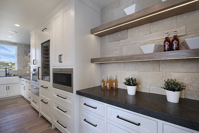 Butlers pantry mitered countertop Located behind the range wall this butler's pantry is fully-equipped with top-the-line appliances Butlers pantry mitered countertop ideas Butlers pantry mitered countertop #Butlerspantry #miteredcountertop