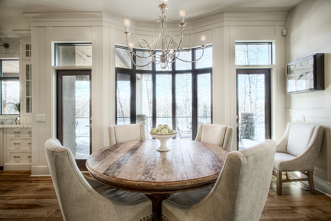 Breakfast Nook windows Bow window flanked by patio doors help define the space for this breakfast nook breakfast nook windows #breakfastnook #windows #bowwindows