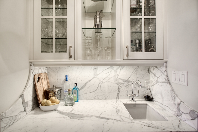 Curved Marble Backsplash The butlers pantry features solid Statuario slab marble countertop and backsplash with a curved return #butlerspantry #curvedmarblebacksplash #marble