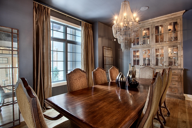 The dining room feels collected and inviting. It features a built-in hutch, black windows and 10' ceilings #Diningroom