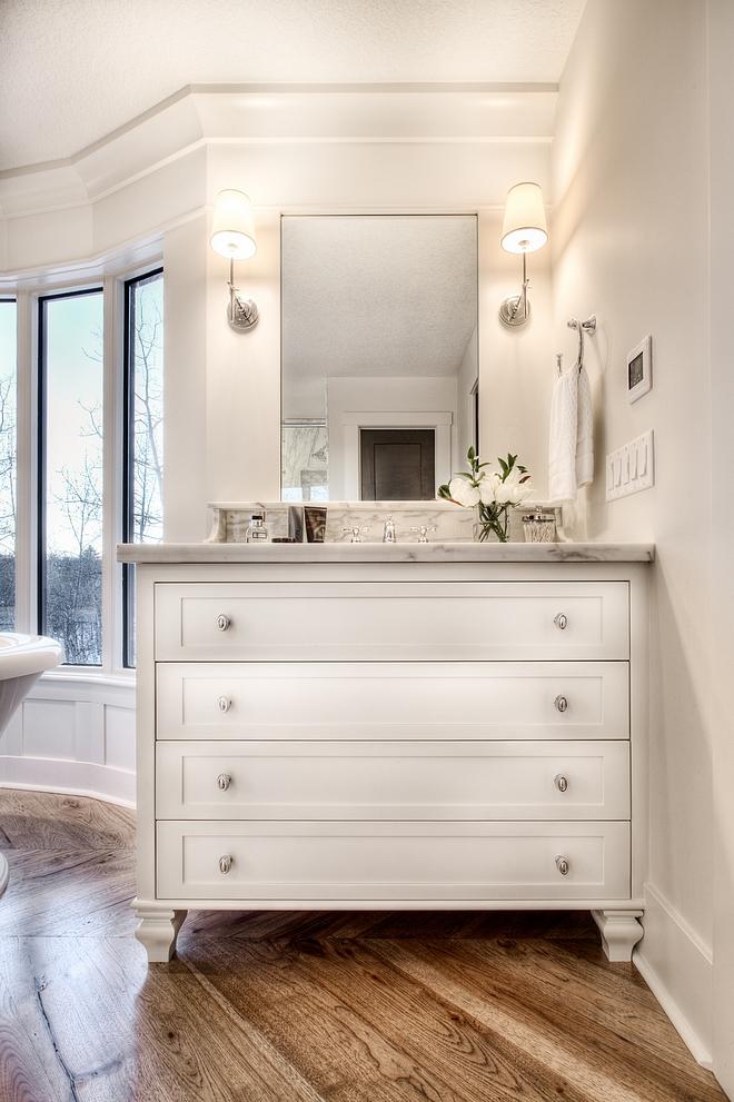 Bathroom vanities are painted in Benjamin Moore Oc-19 Seapearl
