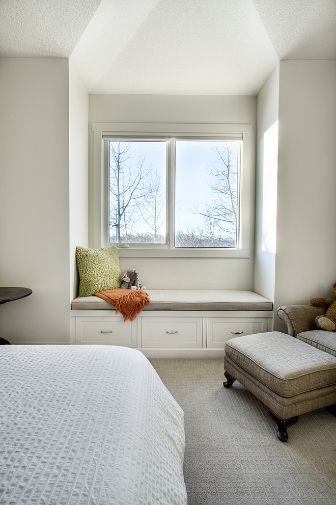 Simple kids bedroom window seat with storage drawers