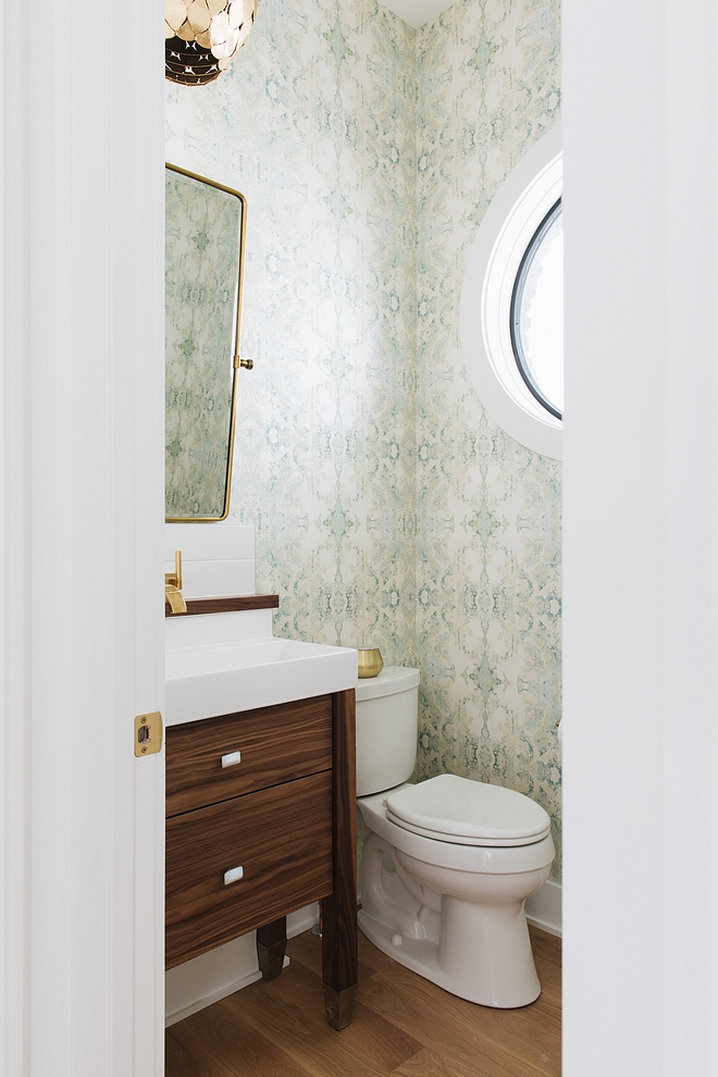 Powder Room The main floor powder room is beautiful and welcoming featuring a mint and metallic gold wallpaper Vanity is Walnut #powderroom #wallpaper #walnutvanity