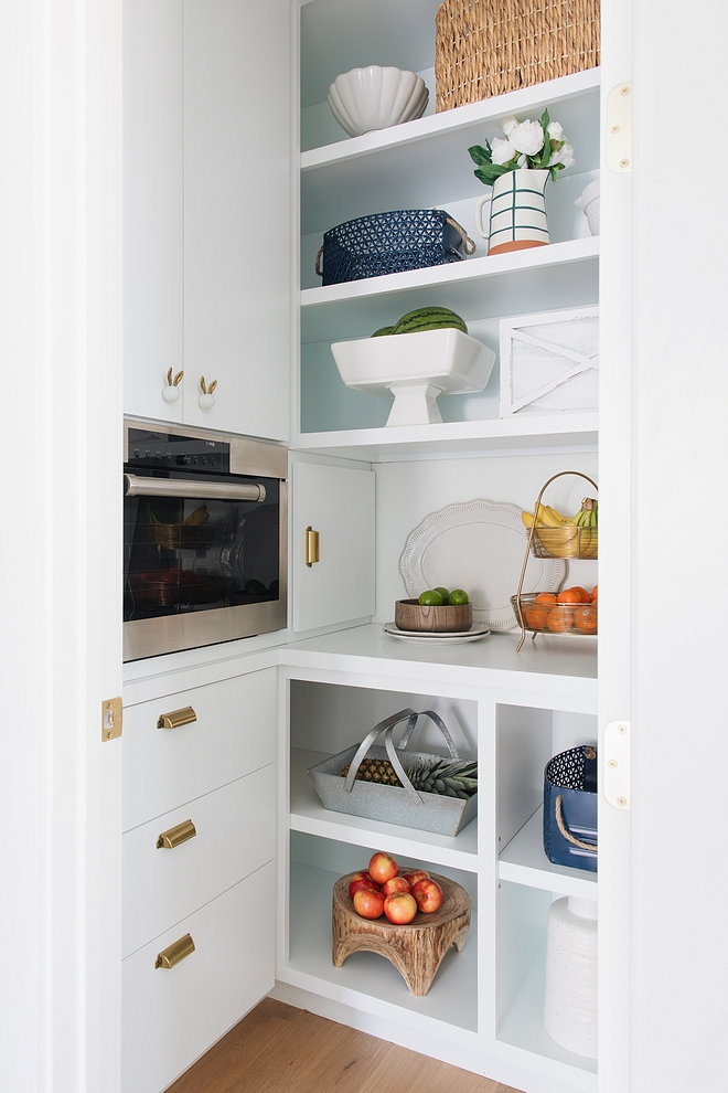 Pantry Kitchen pantry Pantry The pantry features steam oven, whimsy knobs and stylish containers of fruit and flowers #pantry #kitchenpantry