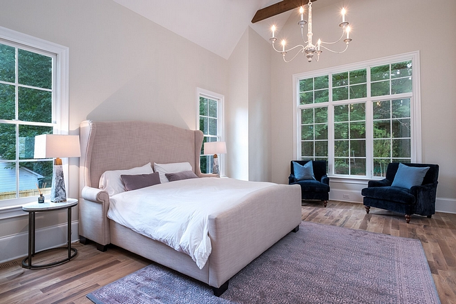 Modern Farmhouse Master Bedroom Windows gets lots of natural light and the 17 foot vaulted ceilings with rough sawn beams add dimension and make the space feel even larger than it is #modernfarmhouse #farmhosuebedroom #windows #beams
