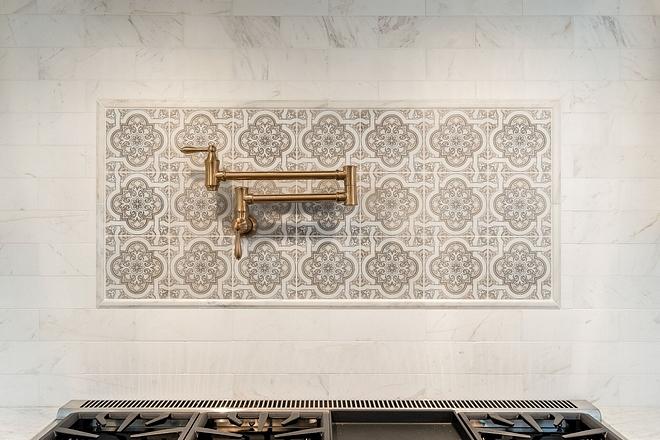 Kitchen backsplash above range Kitchen tile above stove Backsplash is Honed Carrera Marble tile with custom picture frame detail #backsplash