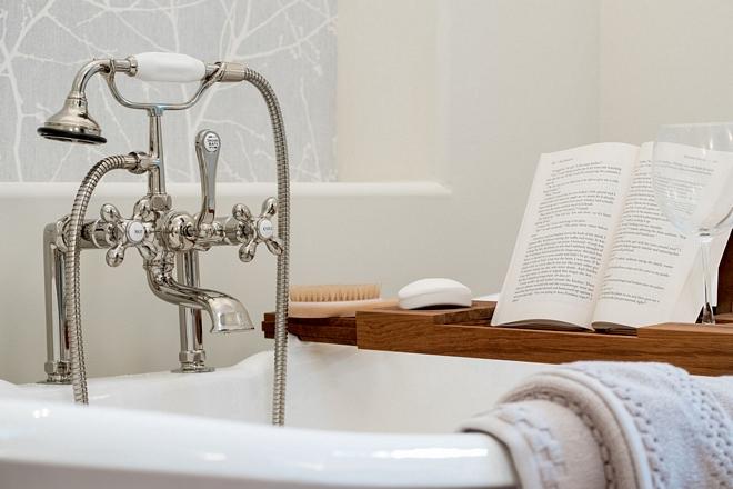 Signature hardware deck mount telephone faucet on cast iron tub timeless bathroom look