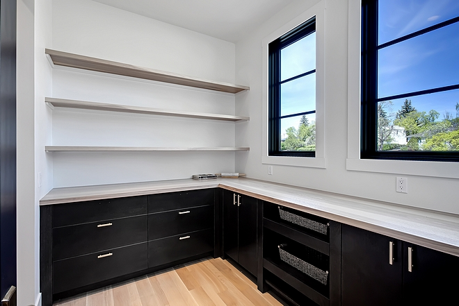 Kitchen pantry Large kitchen pantry A door opens to an extensive pantry with lower cabinets pull-out baskets open floating shelves Floating Shelves and countertop are Hickory wood #pantry #kitchenpantry