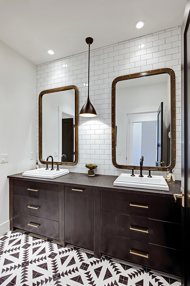 "Bathroom bathroom bathroom features heated 8"" x 8"" black and white cement tiles custom vanity, subway tile from counter to ceiling and a pair of industrial mirrors #bathroom"