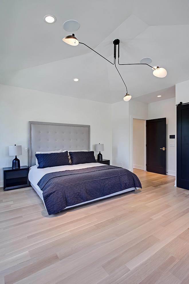 Master Bedroom modern chandelier The master bedroom features a modern chandelier modern chandelier source on Home Bunch modern chandelier #modernchandelier #bedroom