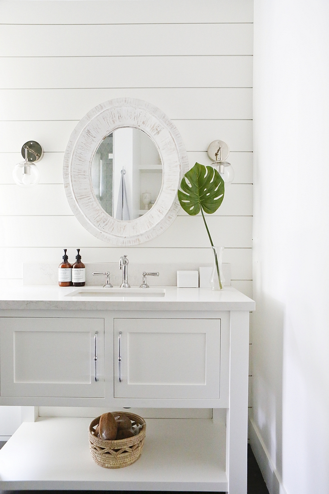 Bathroom Shiplap The bathroom has shiplap on the wall, Calacata Nuvo countertop by Caesarstone and a custom built vanity painted in Simply White by Benjamin Moore #bathroom #shiplap