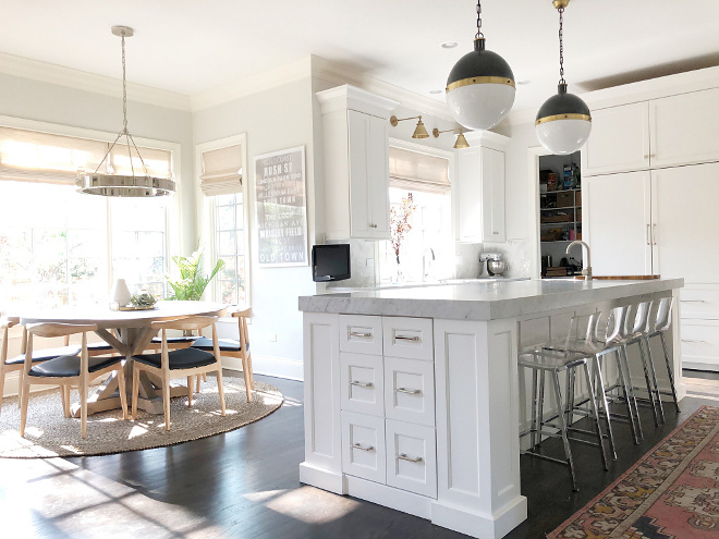 Kitchen and Breakfast Nook Design Ideas Beautiful white kitchen and breakfast room with round table mid-century dining chairs and a ring chandelier Kitchen and Breakfast Nook Design Ideas #kitchen #breakfastnook #beautifulkitchen