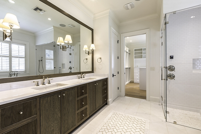 Master bathroom The master bathroom is located between the master bedroom and a large walk-in closet Cabinetry is custom, Ash stained #Masterbathroom
