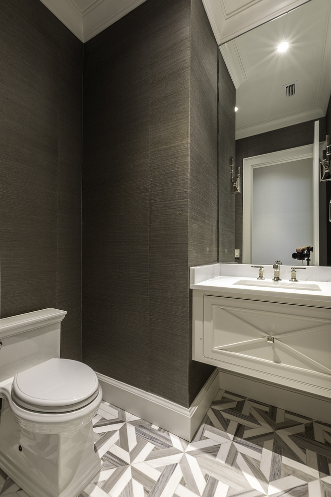 Powder room ideas Adding personality to a powder room chic powder room The powder room features a gorgeous floor tile, a custom floating vanity and a Phillip Jeffries wallpaper #powderroom #tile #floaringvanity #PhillipJeffries #wallpaper
