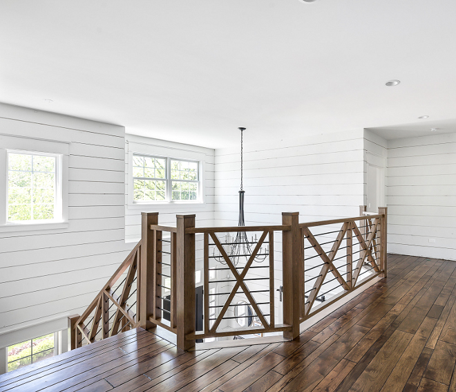 Farmhouse Stair Railing Farmhouse Stair Railing Staircase features a farmhouse 3-Rail criss-cross fence-inspired railing Farmhouse Staircase features a farmhouse 3-Rail criss-cross fence-inspired railing #FarmhouseStairRailing #StairRailing