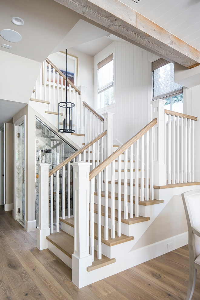 Staircase Millrwork The staircase features White Oak threads, White Oak handrail and vertical tongue and groove paneling #staircase #staircasethreads #WhiteOak #WhiteOakthreads #WhiteOakhandrail #handrail #verticaltongueandgroove #staircasepaneling
