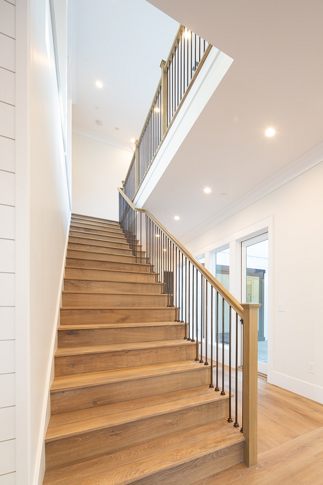 White Oak Staircase The staircase features White Oak threads, custom stained to match the hardwood flooring, metal spindles and White Oak railing and baluster #whiteoak #staircase #whiteoakstaircase #whiteOakthreads #staircasethreads #hardwoodflooring #metalspindles#WhiteOakrailing #railing #baluster