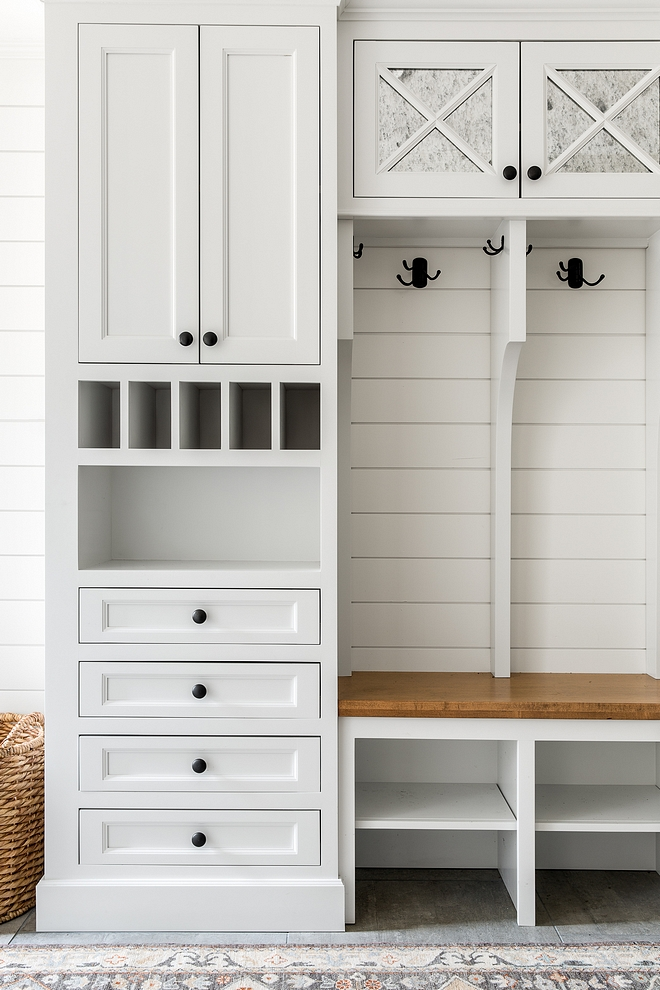 Mudroom Cabinet Dropzone Mudroom Cabinet Dropzone The mudroom upper cabinets are inset with antiqued mirror Mudroom Cabinet Ideas Dropzone Mudroom Cabinet #Dropzone #Mudroom #Cabinet