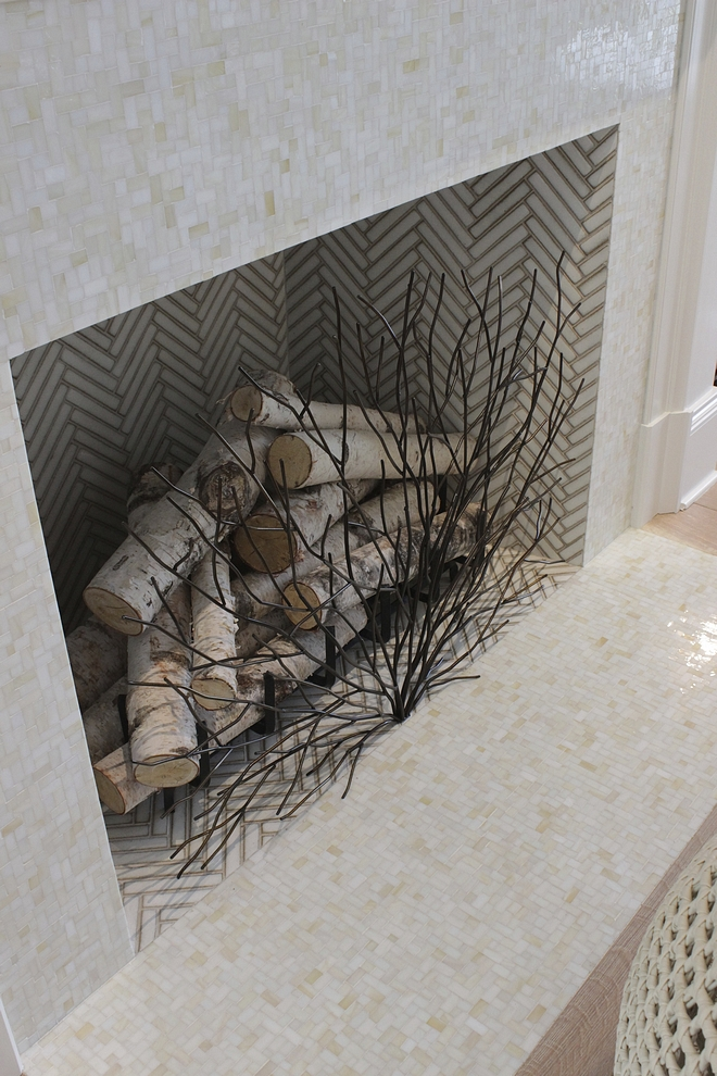 Fireplace Tile The fireplace features mini-mosaic tile and white herringbone tile #fireplacetile