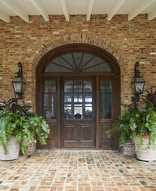 Traditional Front Door This oversized reclaimed Cypress front door, with an elliptical transom and sidelites, adds a traditional but casual element Traditional Front Door Traditional Front Door #TraditionalFrontDoor #TraditionalDoor #FrontDoor