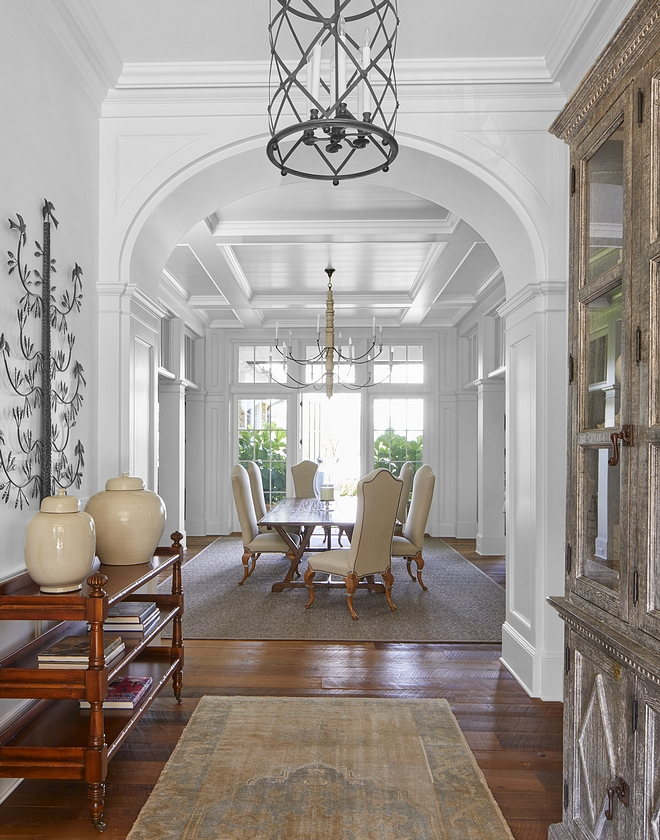 Foyer Traditional Foyer Traditional Interiors The foyer and dining room connect via an elliptical arch, creating a formal association between the front and rear while also allowing natural light to permeate throughout #foyer #entry #traditionalfoyer #traditionalhomes #traditionalinteriors