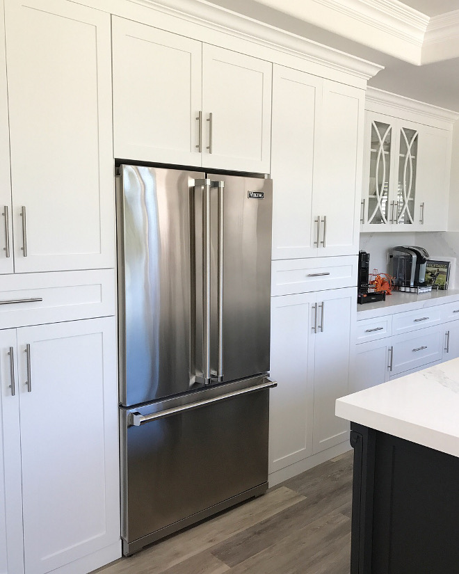 """Shaker style kitchen cabinet surrounding a Viking fridge with French doors The cabinets are custom-made in """"white"""" shaker style with modern hardware#shakercabinets #shakerkitchencabinet #kitchen #Vikingfridge #frenchdoorsfridge"""