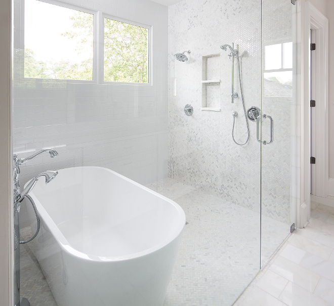 Shower with freestanding tub The master bathroom features a marble wet area with tub and shower to create a streamlined feel to the space #shower #largeshower #showerwithfreestandingbath